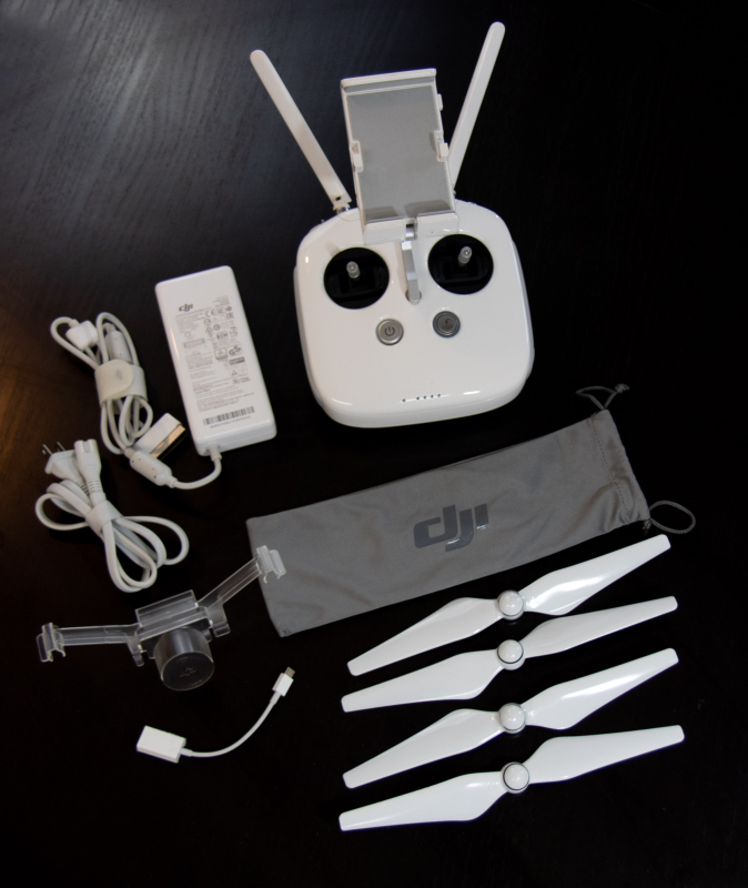 Like New: DJI Phantom 4 Pro Controller | GL300F, battery charger, gimbal stabilizer lock, propellers. Image #1