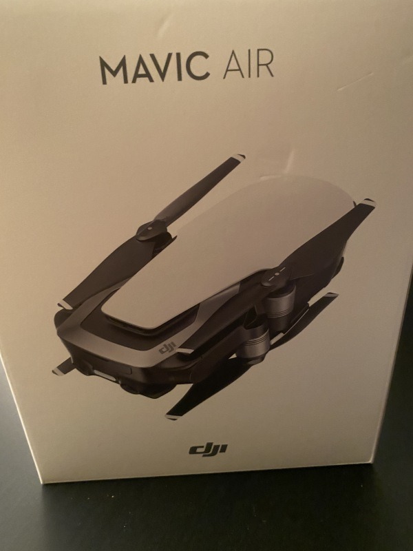 Red mavic Air Fly More Combo with extra Carrying cases 3 batteries with charger that charges all the same time Image #1