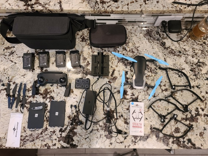 Mavic air onyx black fly more combo with extra battery and accessories Image #1