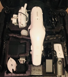 DJI Inspire 1 v2.0 with three batteries, one remote, lens filter, 4 way battery charger and Osmo handheld device. Image