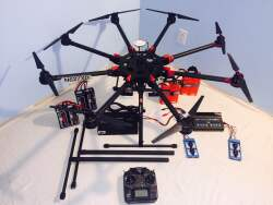 DJI S1000 with two controllers, zenmuse, Battery Charger, Rugged Case and many other items. Image