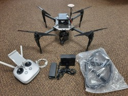 DJI Matrice 100 with ZenMuse X5 camera, GPC hard case w/wheels, and 4 TB47D chargeable batteries Image