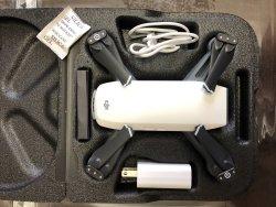 DJI Spark drone with free DJI fidget spinner and DJI keychain Image