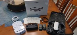 DJI Spark with controller Two DJI batteries and a 4-battery charger Image